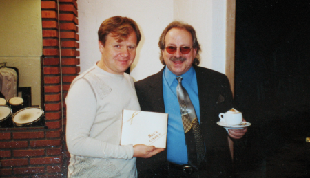 Igor Butman and Jon Hammond backstage before show, Igor holding box of See\'s Chocolate that Jennifer and Jon brought for him from San Francisco California